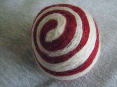 One multicolored felted pincushion Red and White by Dreamcrafter, $8.00