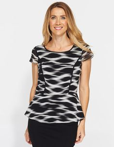 A fantastic top to balance your hips with your upper body. It accentuates your waist without it being super tight. A great blend of black and white, not too harsh. Suitable for all colour seasons.