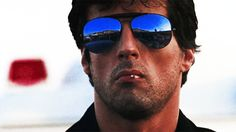 You may be cool, but you'll never be Sylvester Stallone wearing mirrored sunglasses, eating lollipop cool.
