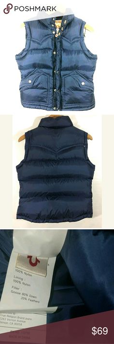 True Religion Puffer Vest Women's Medium Nylon True Religion Puffer Vest Women's Medium Nylon Goose Down Zip Snap Buttons Blue  Excellent used condition.   20 inches pit to pit.  23 inches long.   Pre-owned item condition. Item has little to no signs of wear unless specifically stated. Please carefully review item details and uploaded pictures for details of this item before bidding or buying. Item is functional and ready for your closet!    AB True Religion Jackets & Coats Vests