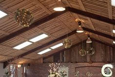 Hanging wicker balls decorated with silk flowers and fairy lights
