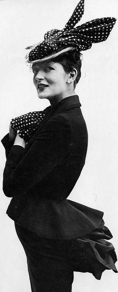 Maxime, Comtesse de La Falaise, suit and hat by Fath.  Photo by Richard Avedon, Paris studio, January 1948.