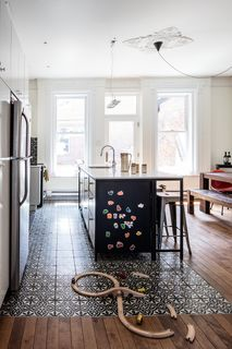 The first floor of this house, built and located in the McGill neighborhood of Montreal, was the perfect spot for a large kitchen and living area, which was missing from the old layout—a makeshift kitchen was previously located on the floor above. Wood Floor Kitchen, Kitchen Flooring, Ikea Flooring, Flooring Ideas, Kitchen Tiles, Vinyl Flooring, Kitchen Cabinets, Kitchen Living, New Kitchen