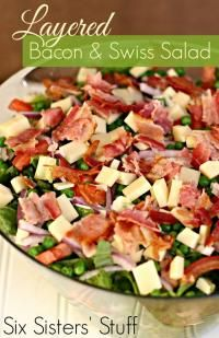 Six Sisters Layered Bacon and Swiss Green Salad Recipe.  This salad shows up at a lot of our family parties!  So delicious!
