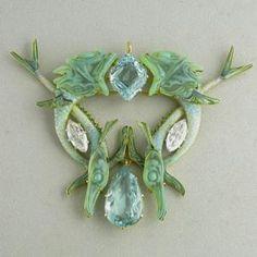 Sublime. Fish pendant. Rene Lalique (1860-1945). Circa 1900. Gold, aquamarine, diamond, enamel, glass.