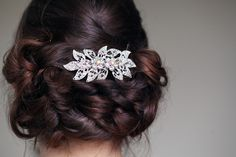 I wanted a low-slung soft bun for my wedding day; my wedding hair stylist (at Toni&Guy in Newbury) worked her magic and created an intricately woven confection of curls and glossy hair held by what must have been a hundred pins but which felt super soft and light. I never felt prettier. | Photograph by our wonderful wedding photographer Barry at Front Page Weddings Photography www.frontpagephotography.co.uk