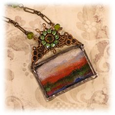 Tiny painting in a necklace