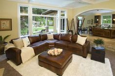 Use brown sectional, use white accents, use wood and stone accents all in living room.