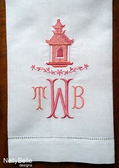 Chinoiserie pagoda monogram embroidered in shades of coral on linen guest towel. Also available in blues, greens, or lavenders. NellyBelle Designs