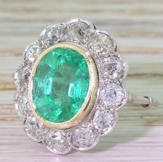 Edwardian 3.26 Carat Colombian Emerald & Old Cut Diamond Cluster Ring, circa 1910