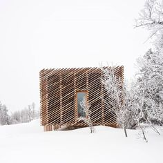 """Dezeen on Instagram: """"This mountain cabin in Kvitfjell, Norway, by @morkulnesarchitects is clad with a diagonal pattern of narrow quarter-cut tree logs, a…"""" Wooden Columns, Wooden Facade, Decking Panels, Modular Cabins, Cladding Materials, Wood Cladding, Timber Cabin, Tree Logs, Built In Furniture"""