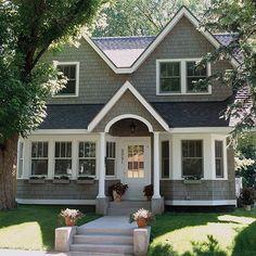 A new upper floor with dormers, a gable over the front entry, and a main-level bay window that brings symmetry to the entry, create a distinct Cape Cod style. Cedar shakes and white trim make the addition look seamless./