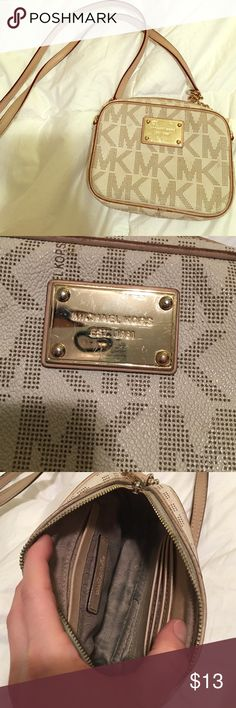 """Michael Kors small crossbody bag Used condition. Has 4 card slots and one slip pocket. About 6"""" across and 1 1/2"""" wide. Michael Kors Bags Crossbody Bags"""