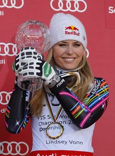 Lindsey Vonn of the USA takes the Overall Downhill World Cup globe during the Audi FIS Alpine Ski World Cup Women's Downhill on March 14, 2012 in Schladming, Austria.