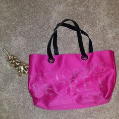 Victoria secret bag! With a gold dog! Hot pink has a couple little blue Marks on it PINK Victoria's Secret Bags Totes