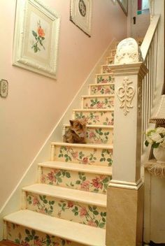 A in cream & roses.stairway that has been painted beautifully.