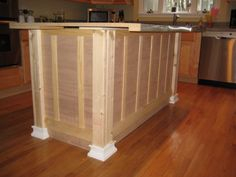 Kitchen Island Base great tutorial for how to put baseboard & legs in an island