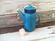 Check out this item in my Etsy shop https://www.etsy.com/listing/182815835/retro-blue-mikasa-teapot-vintage-coffee