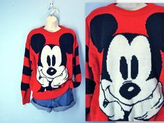 Sweet, vintage 1980s sweater. Soft, slouchy acrylic knit. Mickey Mouse on the front. Black stripes down the sleeves. Dropped shoulders. Roomy