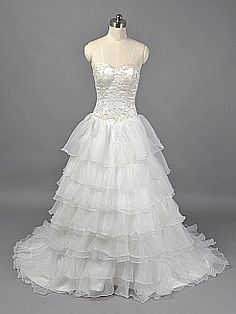 Ivory Sweetheart Appliqued Satin Ball Gown with Ruffled Organza Overlay - USD $183.00