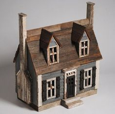 Cape Cod style was strategically built to withstand long winters. The roof has a steep pitch to protect the house from heavy snows. The chimney is connected to all of the fireplaces in each room. Saltbox Houses, Putz Houses, Fairy Houses, Clay Houses, Ceramic Houses, Miniature Houses, Wooden Houses, Small Wooden House, Driftwood Crafts