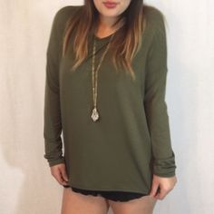 Olive Green Soft Dolman Long Sleeve Top Absolutely loving these new dolmens! They're incredibly soft & versatile! Super lightweight & unbelievably comfortable! 93% Modal 7% Spandex! Available in S M L! True to size! Model is wearing the M! Boutique Tops Tees - Long Sleeve