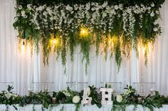 Synthetic bridal table backdrop and personalised marquee lights