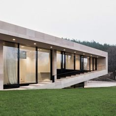 Stone house in Bulgaria by I/O Architects  features a veranda that steps up and down