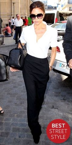 In Paris, Victoria Beckham pounded the pavement in oversize shades, a short-sleeve button-down, a black Maison Martin Margiela maxiskirt and a structured bag of her own design.