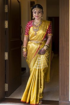 Bride in Golden saree and Red designer blouse Photography Suhitha Shetty Photography Bridal Sarees South Indian, Indian Bridal Fashion, Indian Bridal Wear, South Indian Bride, Indian Sarees, Gold Silk Saree, Wedding Silk Saree, Red Saree, Black Saree