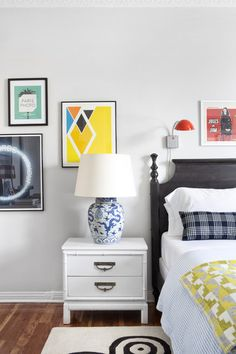 Colorful wall art and graphic patterns in a bedroom
