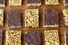 Homemade Protein Energy Bars - I substituted kamut puffs for the rice cereal and added 1/2 tsp. coconut oil to the chocolate topping. Cutting this into 16 squares gives me wonderful little 100-calorie snacks!