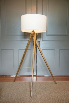 Tripod Floor Lamp in French Wax with Natural Paper Shade by Visual Comfort & Co. Please call our showroom for pricing and availability (706) 227-3560