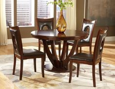 VanBure 5Pcs Dining Set 2568(Dining Table,4 Side Chairs)Classic elegance is achieved with the design of the VanBure Collection. The tabletop features book-match veneers and is gracefully supported by the stately table base. The coordinating chairs feature an oval cutout accent, wood framing and dark brown bi-cast vinyl seating. The entire collection is finished in a rich cherry, further lending to the elegant design.Features:VanBure CollectionRich Cherry FinishDark Brown ColorBi-Cast Vinyl…