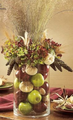 Autumn arrangement  (Pinspiration - omit flowers on top; inside vase: apples, tiny gourds, walnuts in the shell, small dried Indian corn)