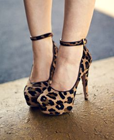 Cute high heeled belted leopard print shoes.