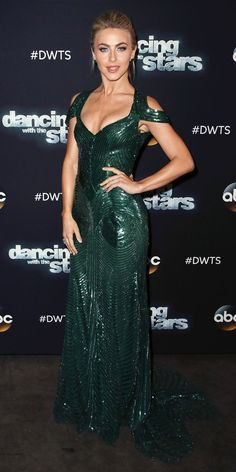 Julianne Hough gave us major va va voom in this glimmering floor length gown with shoulder cut outs and intricate bead detailing. She scaled back on the accessories, keeping the focus on the dress.