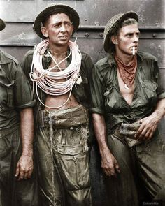 From @war_colourised on Instagram:  Sapper Reginald A. Stevenson (with the fuse cord around his neck) and L/cpl. Raymond C. Mace, two members of the 2/13 Field Company, Royal Australian Engineers, exhausted after the initial attempts to get ashore and blow wire defences at Lingkas on the island of Tarakan, off the coast of Borneo,  30th april 1945