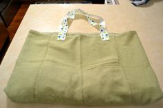 Beach Towel Bag All-In-One.  I want to sew pockets in it too, for holding sunscreen and stuff.