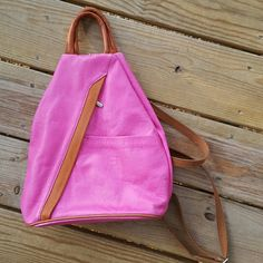 Genuine Leather Pink and Brown Backpack Great condition, flaws are shown in 4th photo, a slight smudge. Made in Hungary. Roughly 10 inches wide at the bottom, about 15 & 1/2 inches from bottom to top hand straps. Color is closest to first photo. Unknown brand. Bags Backpacks