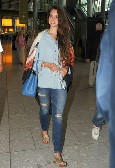 Lana Del Rey wore ripped jeans and a smile after arriving in London June 12.