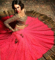 Bright pink lengha by Pooja Rajpal Jaggi. I like how the blouse is detailed and balances out the simple skirt. Pink Lehenga, Lehenga Choli, Anarkali, Lehenga Style, Sabyasachi, Sharara, Indian Attire, Indian Ethnic Wear, Indian Dresses