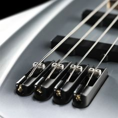 Lodestone Guitar Company uses ceramic bass bridges. Need to find them.