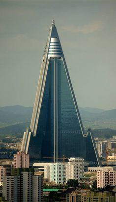 "Ryugyong Hotel is a pyramid-shaped skyscraper under construction in Pyongyang, North Korea. Its name (""capital of willows"") is also one of the historical names for Pyongyang. Unusual Buildings, Interesting Buildings, Amazing Buildings, Modern Buildings, Interesting Photos, Futuristic Architecture, Beautiful Architecture, Art And Architecture, Belle Villa"