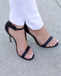 Great black 2 strap black stiletto heel sandals. Minimalist look but so sexy. The manicure helps make this look.