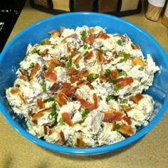 LOADED BAKED POTATO SALAD: 5 lb Red Potatoes, 2 heaped teaspoons Minced Garlic, 2 cartons Sour Cream, 1/2 - 3/4 cup Mayonnaise, 1 teaspoon Red Wine Vinegar, 1 teaspoon Dijon Mustard, 12-16 medium slices Bacon - Cooked and Crumbled, 1 bunch Green Onions, 1 1/2 cup Grated Cheese, salt, pepper