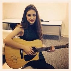 Birdy with her guitar