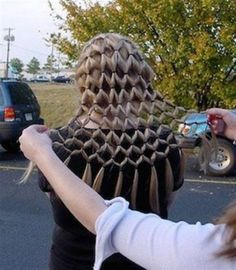 wonder how long it took to do? interesting hair style.