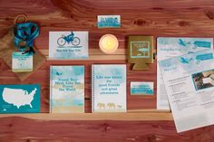 Travel your mind like you travel the world theme for Brookhaven Retreat alumnae reunion event. Custom designed aqua and tan magnets, koozies, handouts, cards, lanyards and notebook giveaways. By Minava Design.