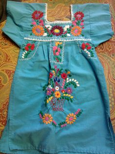 Vintage little girl's Mexican Huipil dress embroidered on turquoise blue.. $17.00, via Etsy.